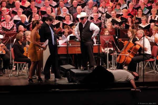 photo of orchestra, conductor dressed as cowboy
